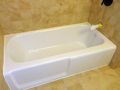 A Shampine refinished standard white tub lined with fresh caulk
