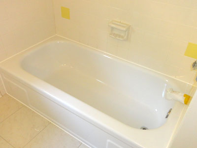 A Shampine refinished standard white tub lined with fresh white caulk